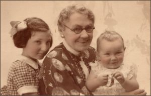 Mrs Flora Woods and grandchildren Robin and Jean Elder