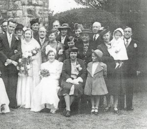 Wedding photograph of James Edward Wright and Elizabeth Ivy Matthews, 20 April 1940, at St Margaret's Church, Putney